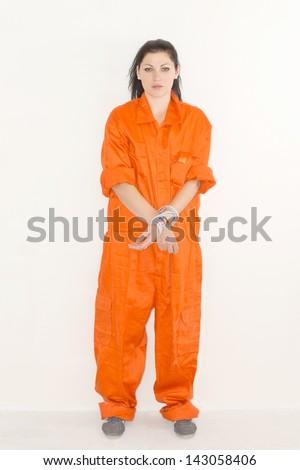 Portrait of female prisoner in orange uniform - stock photo