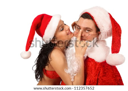 Portrait of female Santa in openwork red lingerie, which  put glasses Santa Claus. Isolated on white. - stock photo
