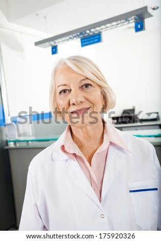 Portrait of female senior researcher smiling in hospital