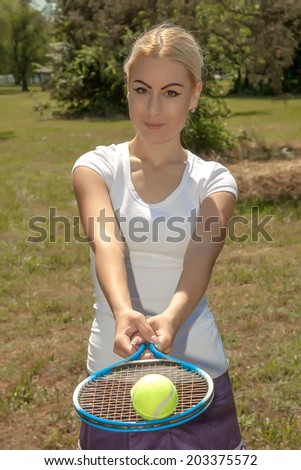 portrait of female tennis player - stock photo