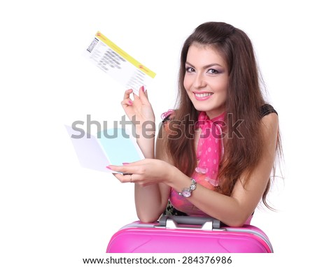 Portrait of female tourist with travel suitcase and boarding pass. - stock photo