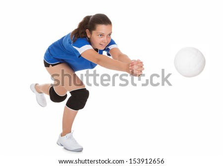 Portrait of female volleyball player isolated on white background - stock photo