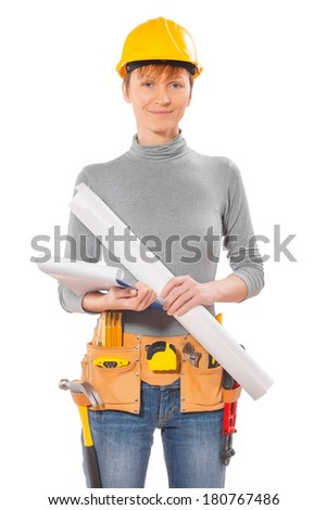 portrait of female wearing working clothes with tools holding blueprint and clipboard isolated - stock photo