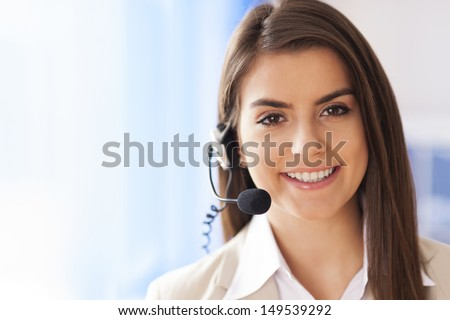 Portrait of female worker customer service - stock photo