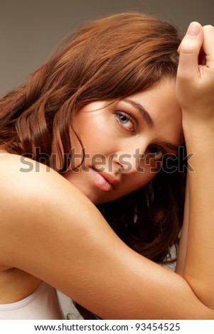 Portrait of feminine woman looking at camera