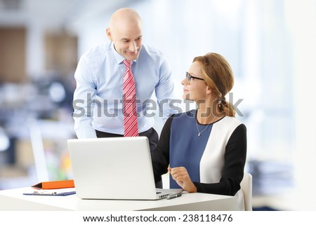 Portrait of financial business people working on business plan while sitting at office. Teamwork. - stock photo