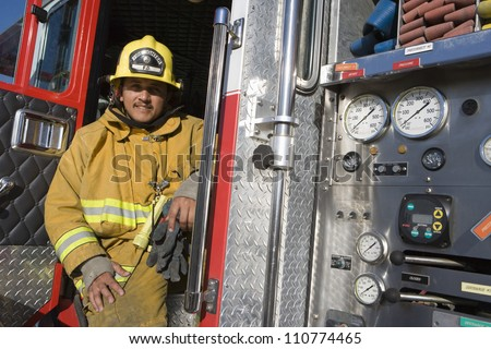 Portrait of firefighter at fire brigade's door