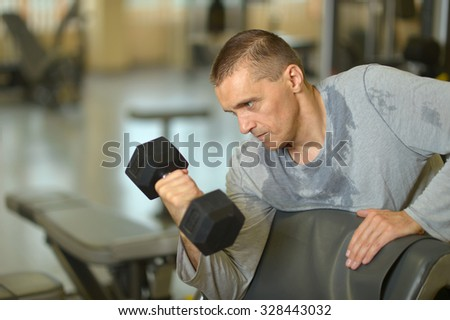 Portrait of fit man exercising at the gym - stock photo