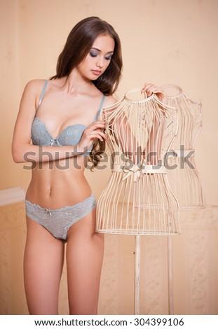 Portrait of fit slender sensual brunette lingerie woman. - stock photo