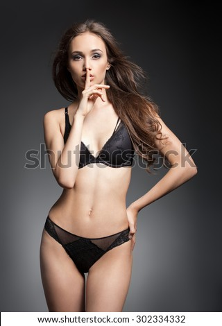 Portrait of fit slender sensual lingerie brunette woman. - stock photo