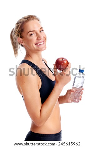 Portrait of fit woman enjoying an apple and water after a workout isolated - stock photo