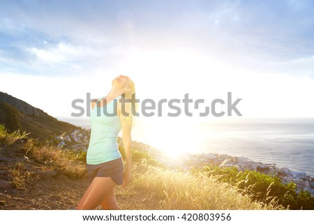 Portrait of fit woman enjoying the outdoors - stock photo
