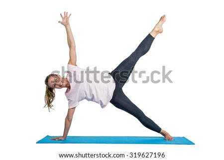 Portrait of fit woman exercising on mat against white background