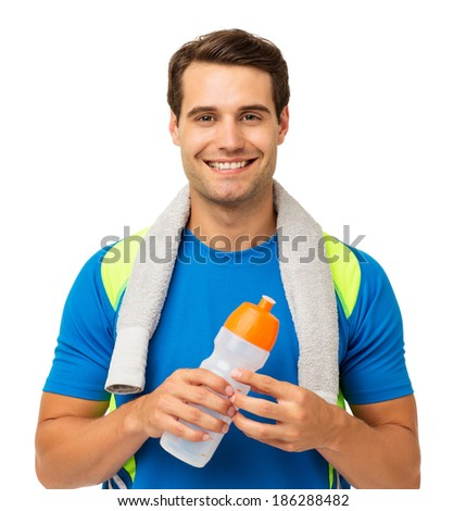 Portrait of fit young man holding water bottle over white background. Horizontal shot. - stock photo