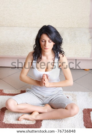 Portrait of fit young woman doing yoga exercise at home - stock photo