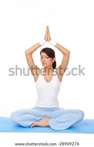 Portrait of fit young woman doing yoga exercise, isolated on white - stock photo