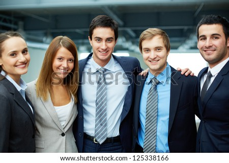 Portrait of five business partners looking at camera with smiles - stock photo