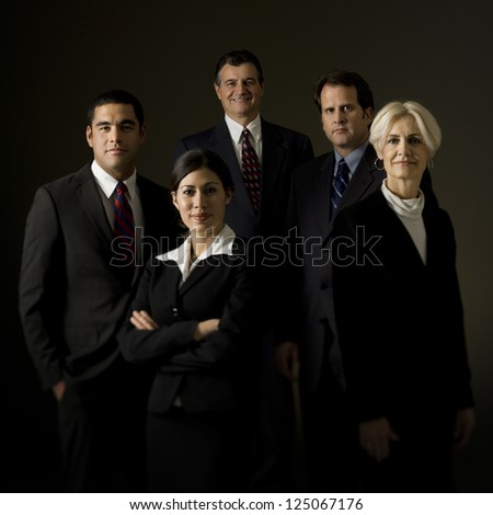 Portrait of five businesspeople standing - stock photo