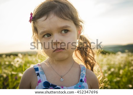 Portrait of five years old caucasian child girl sunset - stock photo