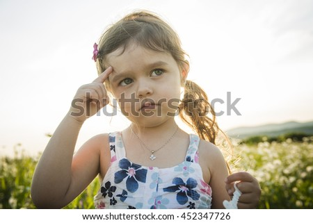 Portrait of five years old caucasian child girl sunset