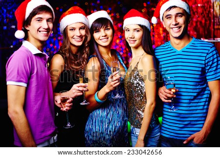Portrait of five young people celebrating New Year - stock photo