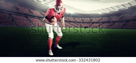 Portrait of focused american football player being ready to attack against rugby stadium