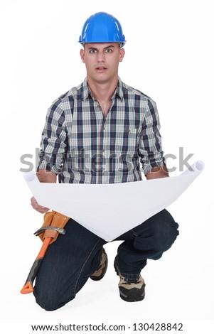 portrait of foreman holding blueprints - stock photo