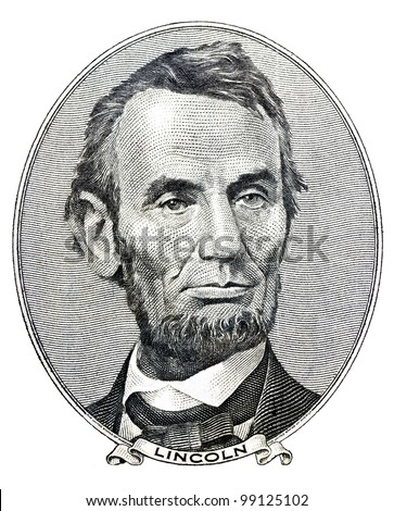 Portrait of former U.S. president Abraham Lincoln as he looks on five dollar bill obverse - stock photo