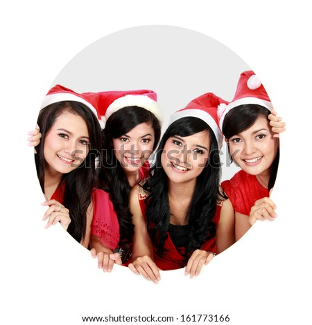 Portrait of four asian women with christmas santa hat in circle - stock photo