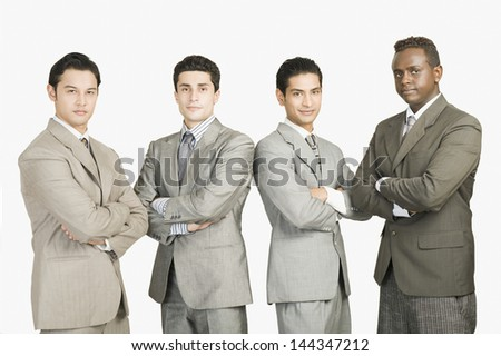 Portrait of four businessmen standing with arms crossed