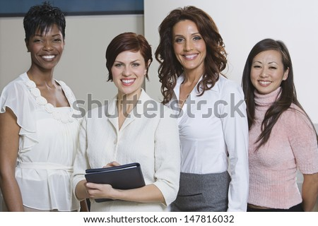 Portrait Of Four Smiling Multiethnic Businesswomen - stock photo