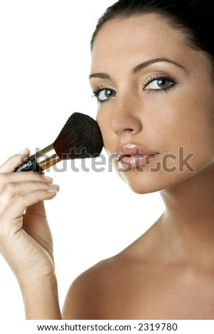 Portrait of Fresh and Beautiful brunette woman doing make up