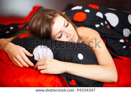 Portrait of Fresh and Beautiful brunette woman on bed - stock photo