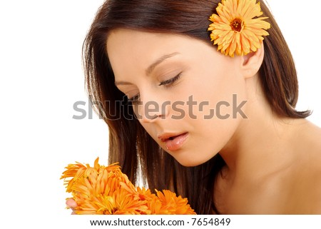 Portrait of Fresh and Beautiful brunette woman  with flowers .orange fower
