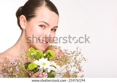Portrait of Fresh and Beautiful girl with flowers