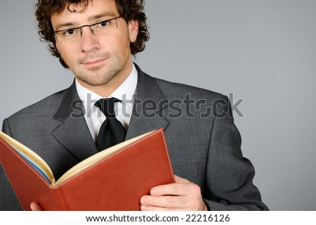 Portrait of friendly businessman - stock photo