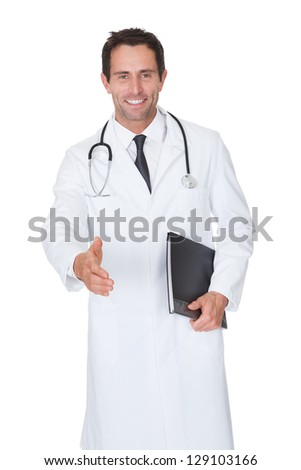 Portrait of friendly doctor offering handshake. Isolated on white - stock photo