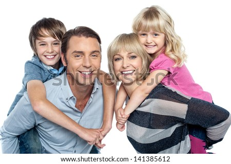 Portrait of friendly family of four in the studio - stock photo