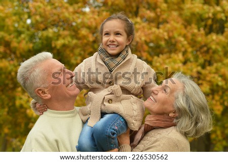 Portrait of friendly family together in autumn park - stock photo