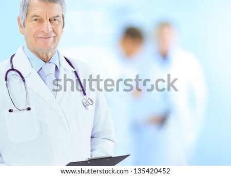 Portrait of friendly male doctor smiling - stock photo