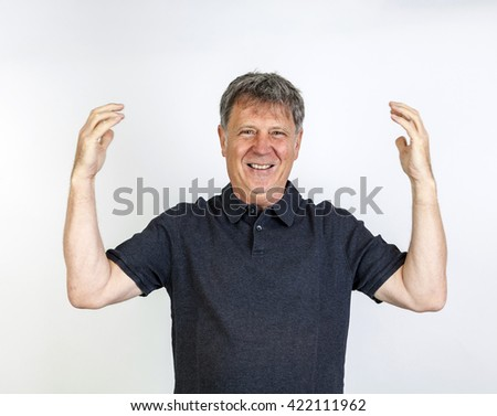 portrait of friendly smiling and gesturing man - stock photo