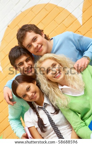 Portrait of friendly students looking at camera with happy smiles - stock photo