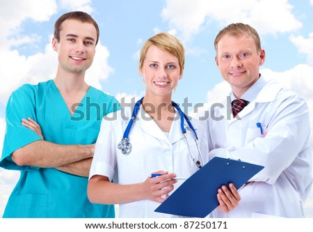 Portrait of friendly therapists standing in line and looking at camera with smiles - stock photo