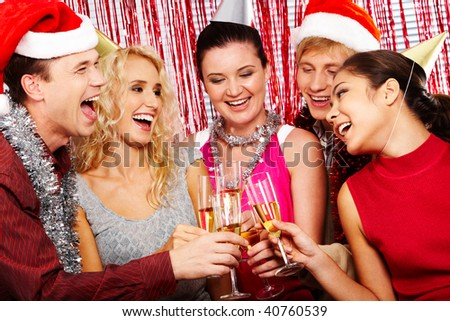 Portrait of friends celebrating someone?s birthday and cheering up - stock photo