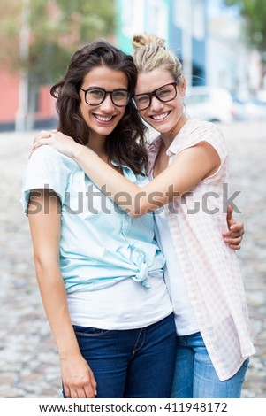 Portrait of friends embracing each other - stock photo