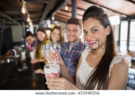 Portrait of friends having drinks in restaurant