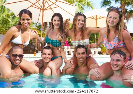 Portrait Of Friends Having Party In Swimming Pool - stock photo
