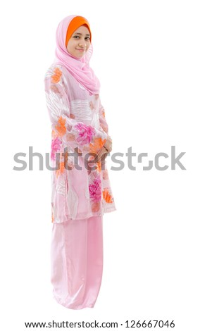 Portrait of full body Southeast Asian Muslim girl smiling, standing on white background
