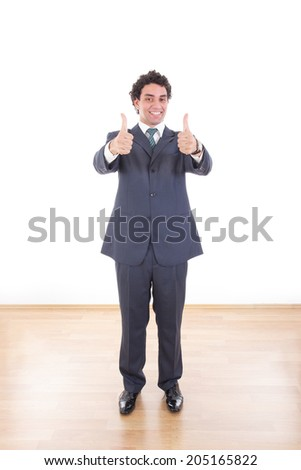 portrait of full length young businessman showing thumbs up with both hands - stock photo