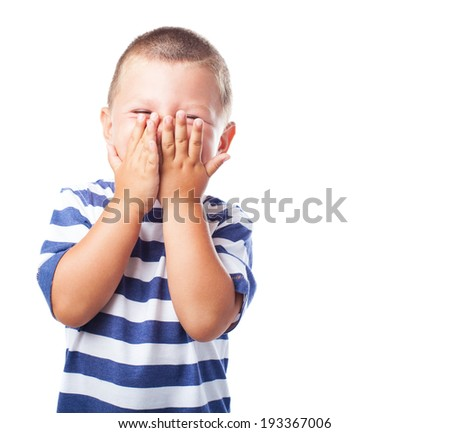 portrait of fun kid covering his face over abstract background - stock photo